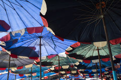 Abstract under big umbrella Royalty Free Stock Photography