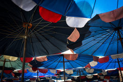 Abstract under big umbrella Stock Photos