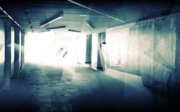 Abstract underground corridor interior with glowing end Stock Photos