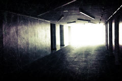 Abstract underground corridor interior with glowing end Stock Photo
