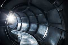 Abstract underground industrial sewerage. Metal tunnel interior Stock Image