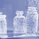 Abstract, underwater composition with small glass bottles. And bubbles royalty free illustration