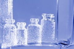 Abstract, underwater composition with small glass bottles. And bubbles stock illustration