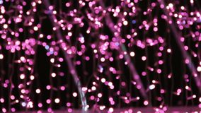 Abstract unfocused backgrounds with Christmas decorations with purple led light bokeh and white ligt comets.  stock video footage
