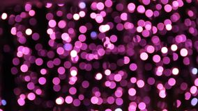 Abstract unfocused backgrounds with Christmas decorations with purple led light bokeh and white ligt comets.  stock footage