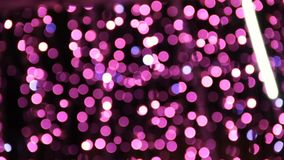 Abstract unfocused backgrounds with Christmas decorations with purple led light bokeh and white ligt comets.  stock video