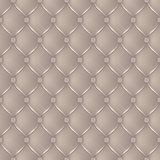 Abstract upholstery on a beige background Royalty Free Stock Photography