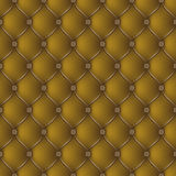 Abstract upholstery dark gold background. Stock Photos