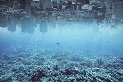 Abstract upside-down water city backdrop. Abstract upside-down city and water, ocean, sea backdrop with copy space. Creativity, abstraction and innovation Royalty Free Stock Image