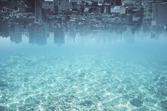 Abstract upside-down water city background. Abstract upside-down city and water, ocean, sea background with copy space. Creativity, abstraction and innovation Royalty Free Stock Photo