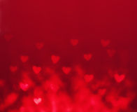 Abstract Valentine's day background with red hearts. Glow Colorf Royalty Free Stock Images