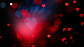 Abstract Valentine's day heart shaped bokeh background in red and blue tones. 