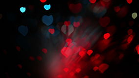 Abstract Valentine's day heart shaped bokeh background in red and blue tones stock footage