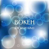 Abstract vector background and blurred lights shining bokeh effect on blue background. Stock Photos