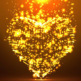 Abstract vector background with glowing heart. Cloud of orange shining points in the shape of a heart. Royalty Free Stock Image