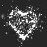 Abstract vector grayscale background with glowing heart. Cloud of white shining points in the shape of a heart. Stock Image