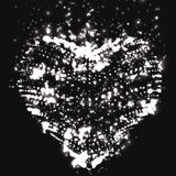 Abstract vector grayscale background with glowing heart. Cloud of white shining points in the shape of a heart.