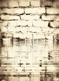 Texture of old white brick wall flooded by flood. stock photography