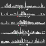 Abstract vector illustrations of Dubai, Abu Dhabi, Doha, Riyadh and Kuwait city skylines at night in grey scales color palette. With flags and maps of UAE Stock Photos