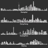 Abstract vector illustrations of Shanghai, Hong Kong, Guangzhou and Beijing skylines at night Royalty Free Stock Photo