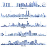 Abstract vector illustrations of Singapore, Kuala Lumpur, Bangkok, Jakarta and Manila skylines in light blue tones isolated on whi Royalty Free Stock Photo