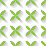 Abstract vector seamless pattern mosaic of green four leaf blooms in diagonal arrangement on white background. Simple. Flat desidn elements with long shadow Royalty Free Stock Photo