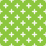 Abstract vector seamless pattern mosaic of white four leaf blooms in diagonal arrangement on green background. Simple. Flat natural design wallpaper Stock Photography