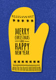 Abstract vector yellow mitten on blue grunge background. Christm Stock Image