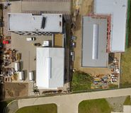 Abstract vertical aerial view of two newly built industrial halls in an industrial area royalty free stock images