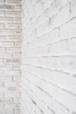 Abstract vertical white background. The corner of the brick wall. Abstract vertical white background. The corner of the brick shabby wall Stock Photo