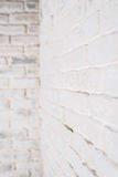 Abstract vertical white background. The corner of the brick wall. Abstract vertical white background. The corner of the brick shabby wall Royalty Free Stock Photo