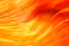 Abstract Vibrant Colored Wave Blur Background. Abstract Vibrant Colored Yellow and Red Wave Blur Background Stock Photography