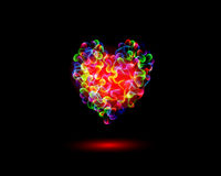 Abstract Vibrant Valentine�s day Heart Symbols on black background Royalty Free Stock Image