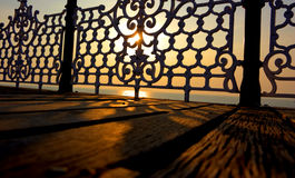 Abstract Victorian Railing. At sunset reflecting on wooden planks Stock Image