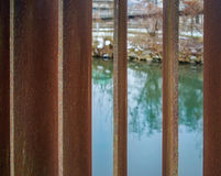 Abstract view through bars onto river Stock Photo
