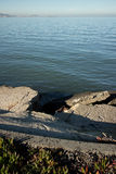 Abstract View of Broken Concerete and Calm Ocean Bay in Late Afternoon Stock Photos