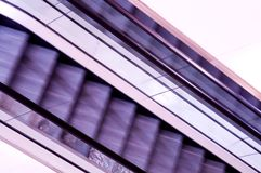 Abstract view of purple escalators Stock Photos