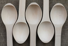Abstract view of five wooden spoons. On natural fabric Stock Images