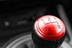 Abstract view of a gear lever, manual gearbox, car interior details. Black and white, red. Stock Image
