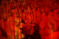 Lord Ganesh in Red Curtains. An abstract view of hindu elephant God Ganesha behind red transparent curtain Stock Photography