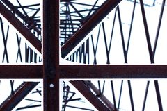 Abstract view of a huge pillar of metal conducting electricity. royalty free illustration