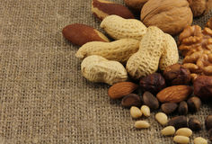 Abstract view of the mixture of nuts. On the background of natural fabrics Stock Photo