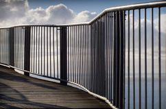 Boardwalk leading to Cape Tourville Lighthouse. Abstract view of railing and  walkway to Cape Tourville Lighthouse, Freycinet National Park, Tasmania, Australia Royalty Free Stock Image