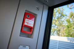 Abstract view on red emergency brake handle near to automatic doors in the new modern European passenger train. Passenger and trai. N safety concept royalty free stock photos