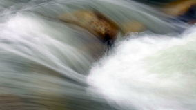 Abstract view of rushing water flowing down the river stock video footage
