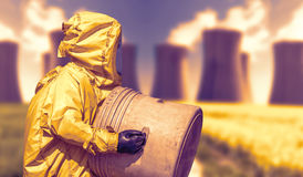 Abstract view of smoking coal power plant and men in protective hazmat suit Royalty Free Stock Photo