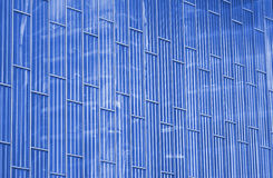 Abstract view to steel blue background of glass facade Stock Photos