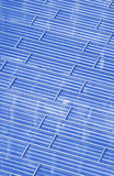 Abstract view to steel blue background of glass facade Stock Image