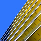 Abstract view of a yellow building against a summe Stock Images