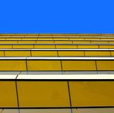 Abstract view of a yellow building against a summe Stock Photography
